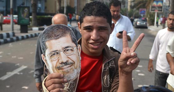 Former Egyptian president Mohamed Morsi was defiant as his trial began, claiming to be the country's legitimate ruler. Egypt-based freelance writer <b>Vickie Smiles</b> reports on the chaotic proceedings.