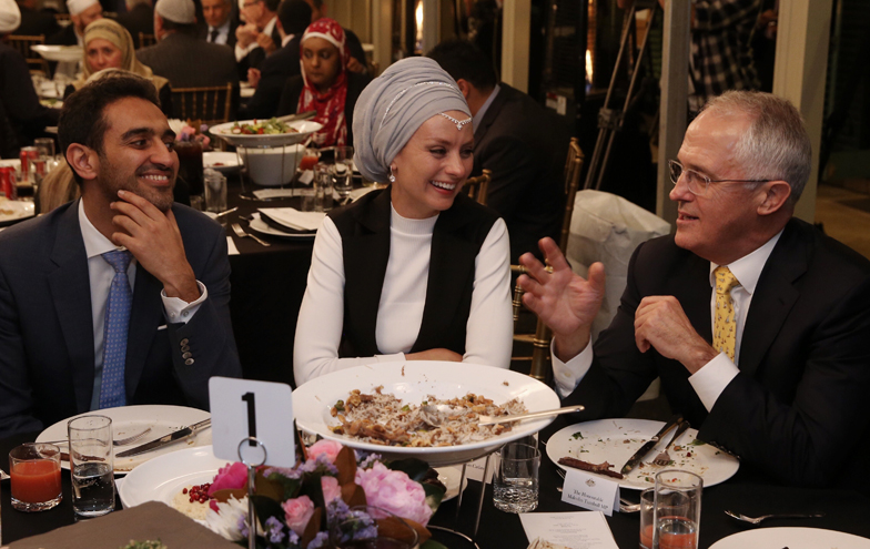 Waleed Aly and Susan Carland speak with Malcolm Turnbull at last week's Iftar dinner at Kirribilli House.
