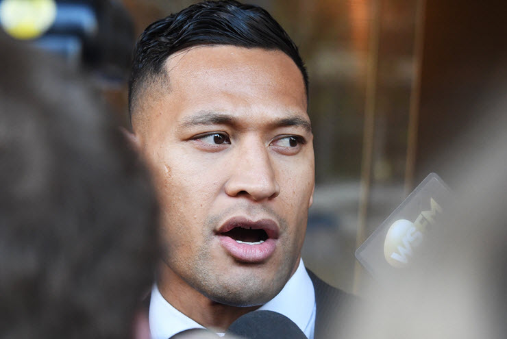 Israel Folau leaves a conciliation hearing at the Fair Work Commission in Sydney. (Image: AAP/Peter Rae)